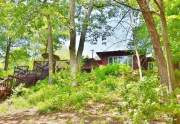 Wooded, lakefront location