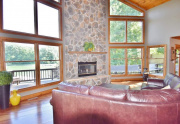 Wood burning floor-to-ceiling stone fireplace