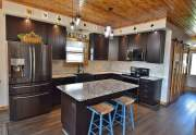 Black stainless appliances and farmhouse sink