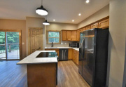 Black stainless appliances and large pantry